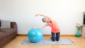side bend on the ball for pregnancy stretch